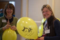 Sylvia Clayden (L) and Vicki Lowes (R) preparing balloons to give away to children at the Wiltshire Bee & Honey Day 2019