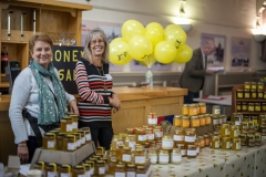 Angela Barlow and Pippa Gillham selling honey at the Wiltshire Bee & Honey Day 2019