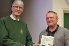 WBKA President Alan Stonell presents the Basic Certificate in Beekeeping to a beekeeper at the Wiltshire Bee & Honey Day 2019