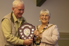 Frank Lenert accepts the Kennet Perpetual Trophy on behalf of Geraldine Lenert (West Wilts BKA) from Mayor Judy Rose, for the best non-honey entry in the show at the Wiltshire Bee & Honey Day 2019